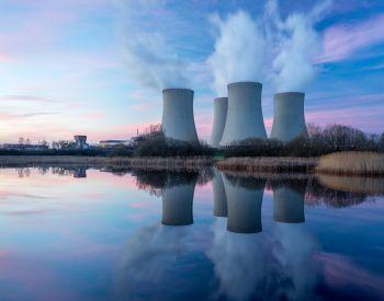 Nuclear power plant with dusk landscape.